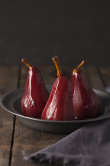 Poached pears in red wine on plate - ECF000360