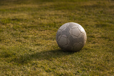 Old football on grass, close-up - KJF000270