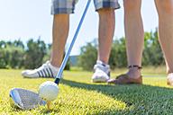 USA, Texas, Two people golfing - ABAF001020