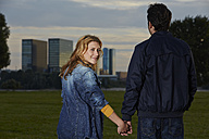 Germany, Dusseldorf, Young couple holding hands - STKF000468