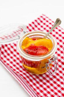 Peperoni grigliati in a glass on wooden table - LVF000264