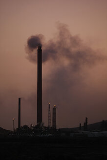 Curacao, Willemstad, Old oil refinery at dusk - RD001194