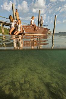 Germany, Baden-Wurttenberg, Wallhausen, Lake Constance, family taking a break on jetty - SH000900