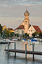 Germany, Bavaria, Lake Constance, Wasserburg, St George's Church with boats in harbour - SH000888