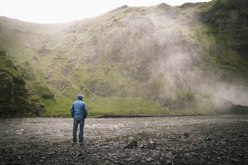 Iceland, Tourist at Skogafoss Waterfall - MBEF000763