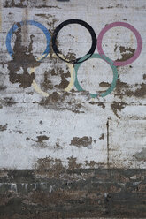 Germany, Cologne, Decaying olympic rings on house facade - JAT000397