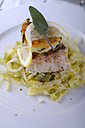 Nile perch on pointed cabbage, with risotto fritter on plate - ODF000603