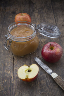 Apple puree in bottling jar and apples on wooden table - LV000274