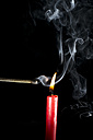 Burning candle with matchstick - PSAF000011