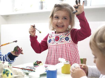 Children painting Easter eggs - FS000326
