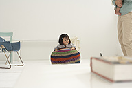 Little Asian girl hanging on a seat - FSF000090