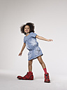 Girl in large clown shoes - FSF000040