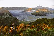 Indonesia, Java, Bromo Tengger Semeru National Park, Tourist looking down to Bromo Volcano - MBEF000801