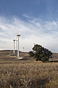Spain, Andalusia, Cadiz, wind turbines standing on a field - KBF000003
