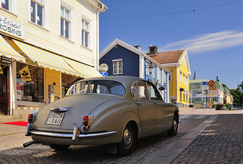 Sweden, Smaland, Vimmerby, Vintage car on cobblestone street - BT000085