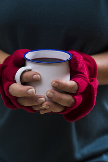 Hands of a woman holding glass with hot wine punch - STB000111