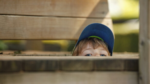 Little boy hiding at playground - RDF001229