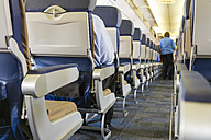 Commercial airplane interior with seats and aisle - ABA001048