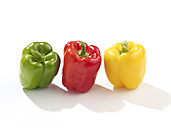 Row of red, green and yellow bell peppers - SRSF000340