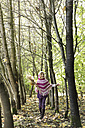 Germany, Vilsbiburg, Girl in forest, wearing poncho - STB000131