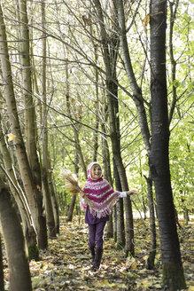 Germany, Vilsbiburg, Girl in forest, wearing poncho - STB000131