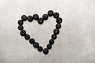 Blueberries forming heart on sheet metal - AWDF000719