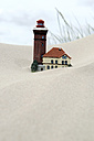 Germany, Amrum, Models of lighthouse and house in sand - AWDF000727