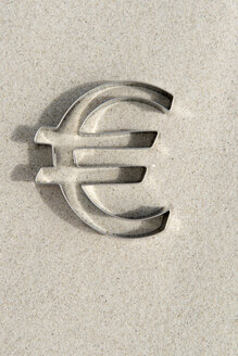 Euro-sign shaped cookie cutter on sand - AWDF000706