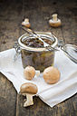 Fresh and pickled brown mushrooms (Agaricus) on wooden table, studio shot - LVF000304
