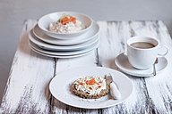 German dark multi-grain bread with cream cheese and carrots, cup of coffee on wooden table - SBDF000325