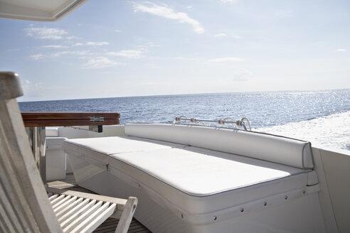 Italy, Sardinia, Chair on yacht deck - PDF000581