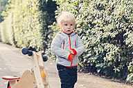 Germany, Bonn, Little boy with wood tricycle - MFF000609
