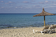 Spain, Formentera, Es Arenals, sunshade and beach chairs - CM000017