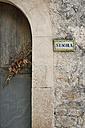 Spain, Majorca, Orient, entrance door of school building - HL000273