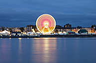 Germany, Cologne-Deutz, View of ferris wheel during fair at Rhine - OD000671