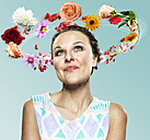 Young woman with flying flowers around her head, Composite - STKF000499