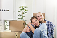 Young couple enjoying new home - FKF000330