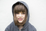 Portrait of smiling little girl with hoodie jacket - LVF000314