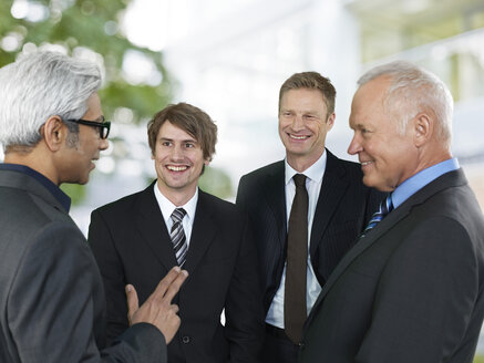 Conversation of four business men - STKF000514