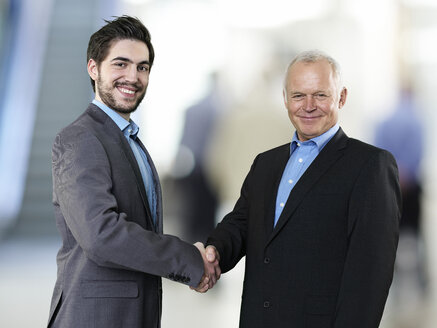 Portrait of two business men shaking hands - STKF000535