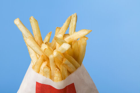 French fries in paper bag, studio shot - WSF000010