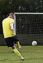 Soccer player scoring a goal - STKF000673
