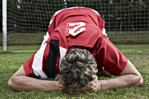Frustrated soccer player on field - STKF000538