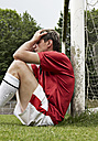 Frustrated soccer player on field - STKF000674
