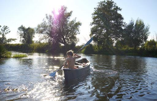 Germany, Brandenburg, Boy paddeling on Spree river - TKF000166