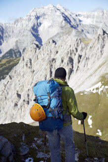 Austria, Tyrol, Karwendel mountains, Hiker in mountains - TKF000179