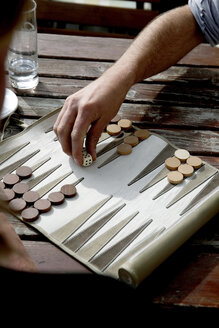 Austria, Tyrol, Men playing backgammon - TKF000217