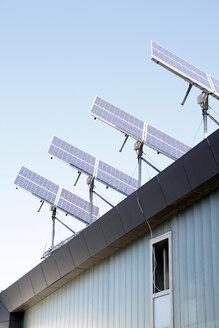 Germany, Berlin, Solar panels on roof top - JM000246