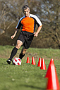 Soccer player passing a slalom course - STSF000221
