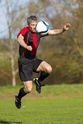 Soccer player with ball on field - STSF000215